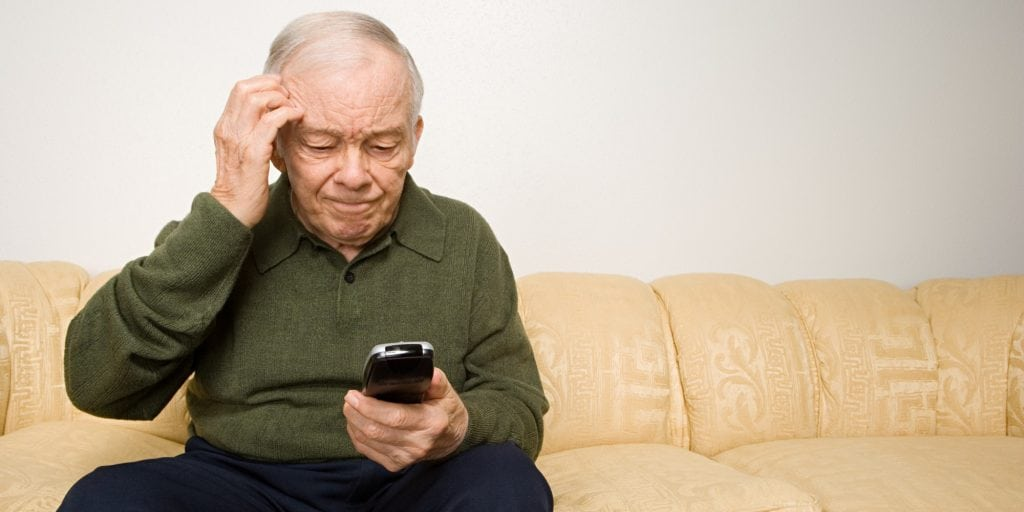 Confused elderly man with remote control